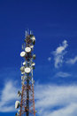 Communications tower with a beautiful blue sky Stock Image