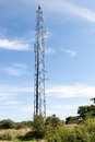 Communications tower in the countryside tall lattice steel with transmitters and receivers for relaying broadcasts and Royalty Free Stock Photos