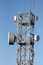 Communications tower with radio and microwave links Royalty Free Stock Photo