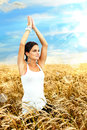 Communing with nature beautiful young woman doing yoga and meditation in hdr light effects Stock Photo