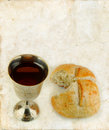 Communion Wine and Bread on grunge Stock Photo