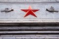 Communist red star patriotic above a hutong home in beijing Stock Images