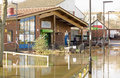 Community centre in floods basingstoke england february the ridgeway surrounded by flood waters where many residents have Stock Photos