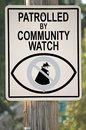 Community watch sign signs warns that is patrolled by group Stock Images