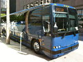 Commuter bus blue parked at the curb in the city Stock Images