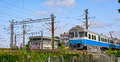 Commuter train arrives at station central railway in helsinki finland Stock Photography