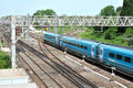 Commuter train english rail network with a blue rushing by Stock Photos