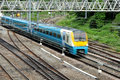 Commuter train english rail network with a blue rushing by Stock Photography