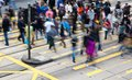 Commuters crossing a busy crosswalk Royalty Free Stock Photo
