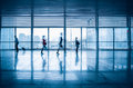 Commuters motion blurred in modern corridor with high speed rail station Royalty Free Stock Photos