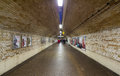 Commuting in tunnel london march people blurred by long exposure a symmetrical the london underground london uk march Stock Photo