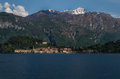 Como lake in italy beautiful scenery surrounded by snow capped mountains and lush forrest Royalty Free Stock Photo