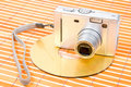 Compact digital camera and dvd disk Royalty Free Stock Photo