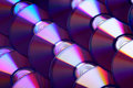 Compact discs background. Several cd dvd blu-ray discs. Optical recordable or rewritable digital data storage. Royalty Free Stock Photo