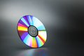 Compact disk on grey Royalty Free Stock Photo
