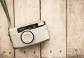 Compact film camera on wood Royalty Free Stock Photo