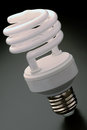 Compact fluorescent light bulb details of a modern energy efficient cfl gray gradient background Royalty Free Stock Image
