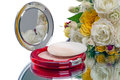 Compact powder mirror and flower Royalty Free Stock Photo