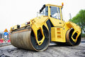 Compactor roller at asphalting work Royalty Free Stock Images