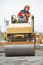 Compactor roller at road work light vibration urban construction and repairing asphalt pavement works Stock Photo
