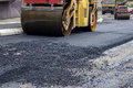 Compactor rollers during road construction at asphalting work Royalty Free Stock Images