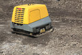 Compactor vibrating soil with remote control via radio Royalty Free Stock Photo