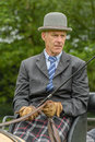 Companion animals horses male carriage driver waiting to start with his dressage exercise Stock Photos