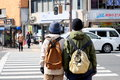 Companions at the zebra crossing on the street of kyoto japan photo was taken Stock Image