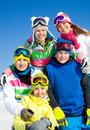 Company of friends on ski holiday group young people in mountains Stock Photos