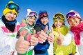 Company of friends on ski holiday group young people in mountains Stock Photo