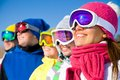 Company of friends on ski holiday group young people in mountains Royalty Free Stock Images