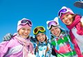 Company of friends on ski holiday group young women in mountains Stock Photography