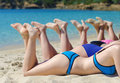 Company of girls sunbathing on the beach Stock Photos