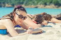 Company of girls sunbathing on the beach Royalty Free Stock Photography