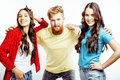 Company of hipster guys, bearded red hair boy and girls students having fun together friends, diverse fashion style Royalty Free Stock Photo