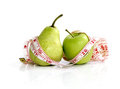 Compare an apple to a pear measuring tape on and manual focus Royalty Free Stock Photography