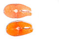 Comparison between wild and farmed salmon blocks on white backgr Royalty Free Stock Photo