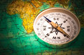 Compass on a card the lies the modern world map Royalty Free Stock Photography