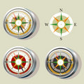 Compass with color variations and wind rose Stock Images
