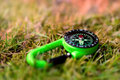 Compass on the grass close up outdoors concept image Stock Image