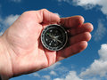 Compass in hand isolated Royalty Free Stock Photo