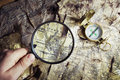 Compass and magnifying glass Royalty Free Stock Photo