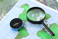 Compass and magnifying glass Stock Photography