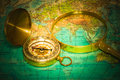 Compass and magnifying glass lie on the topographic map Royalty Free Stock Photography