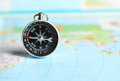 Compass on a map close up Royalty Free Stock Photo