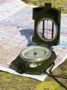 A compass and a mountain map Royalty Free Stock Photo