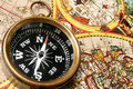 Compass & old world map Stock Photos