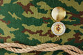 Compass and rope on a camouflage background Royalty Free Stock Photos