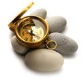 Compass and sea stones on white Stock Photos