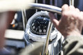 A compass, a view from above the steering wheel on a yacht. Royalty Free Stock Photo